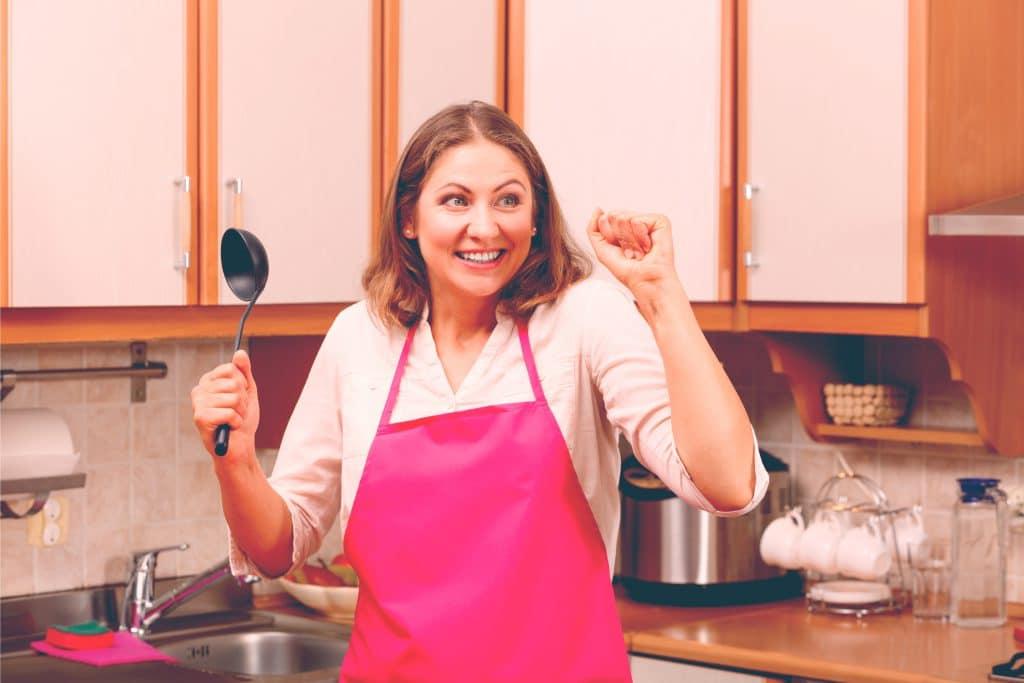 happy mother in kitchen