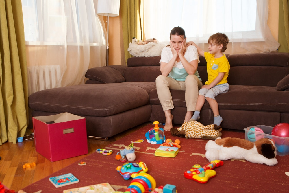 mother and kid in messy living room