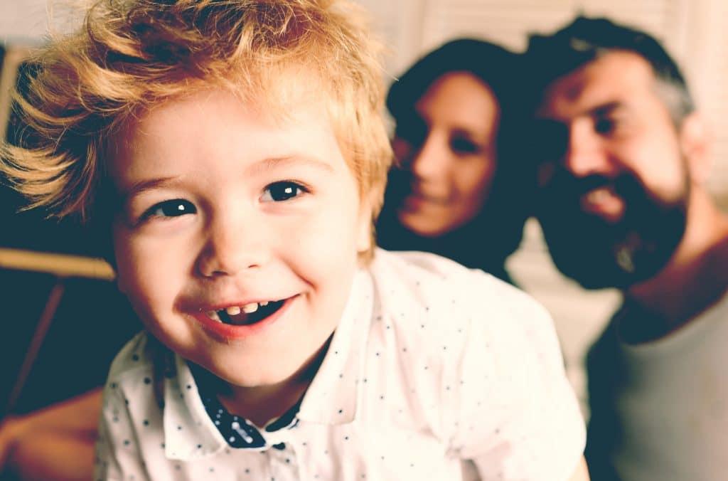 proud little boy with parents