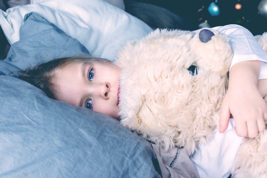 kid in bed opened eyes