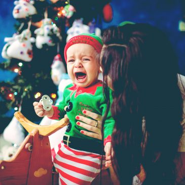baby cry with mother xmas