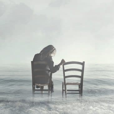 sad woman look at empty chair