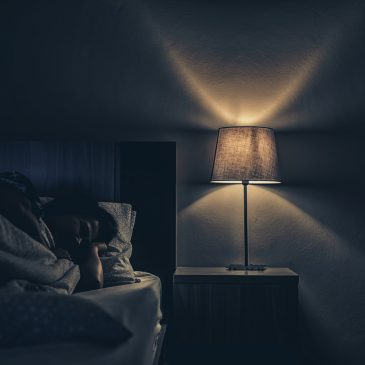 anxious woman in bed