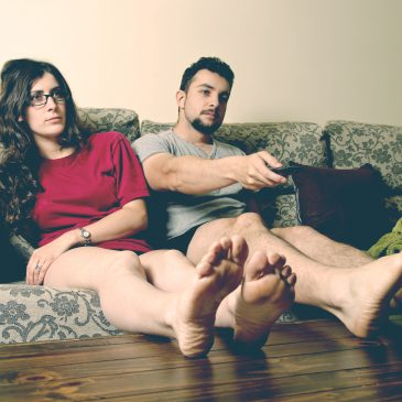 indifferent couple on couch