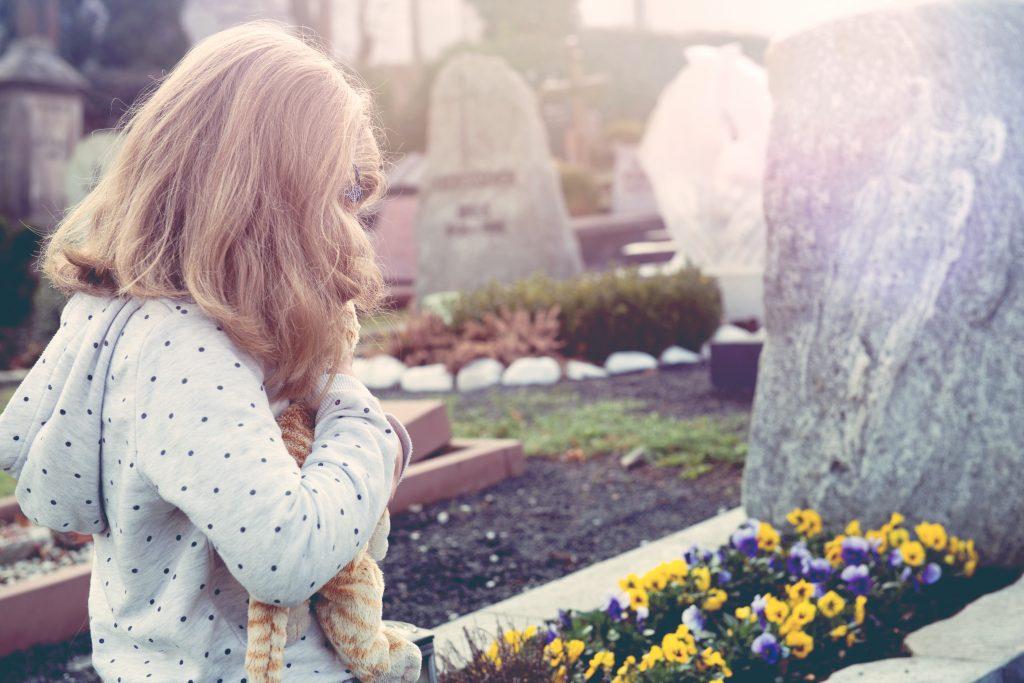 little girl in graveyard