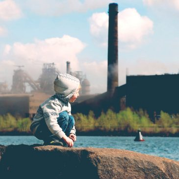 kid look at pollution