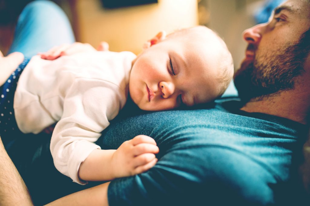 baby sleep on father