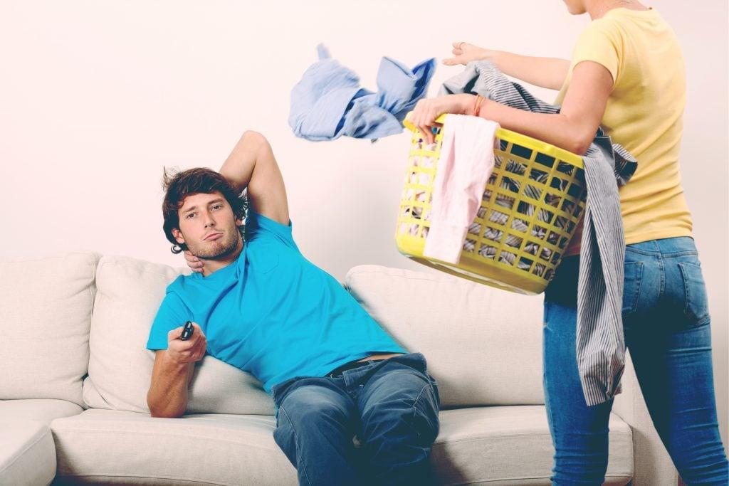 woman doing laundry lazy man