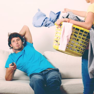 woman doing laundry lazy man