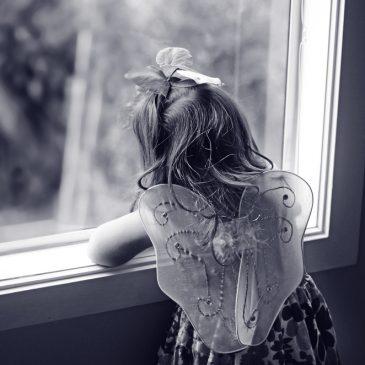 sad girl looking at window