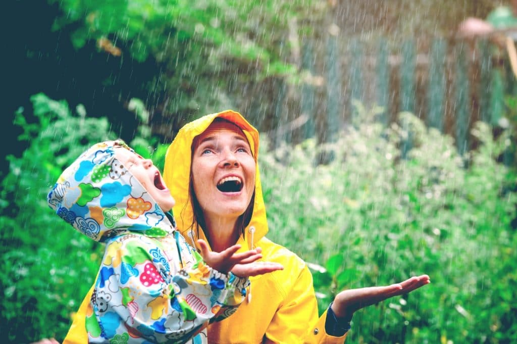 mother with kid under the rain
