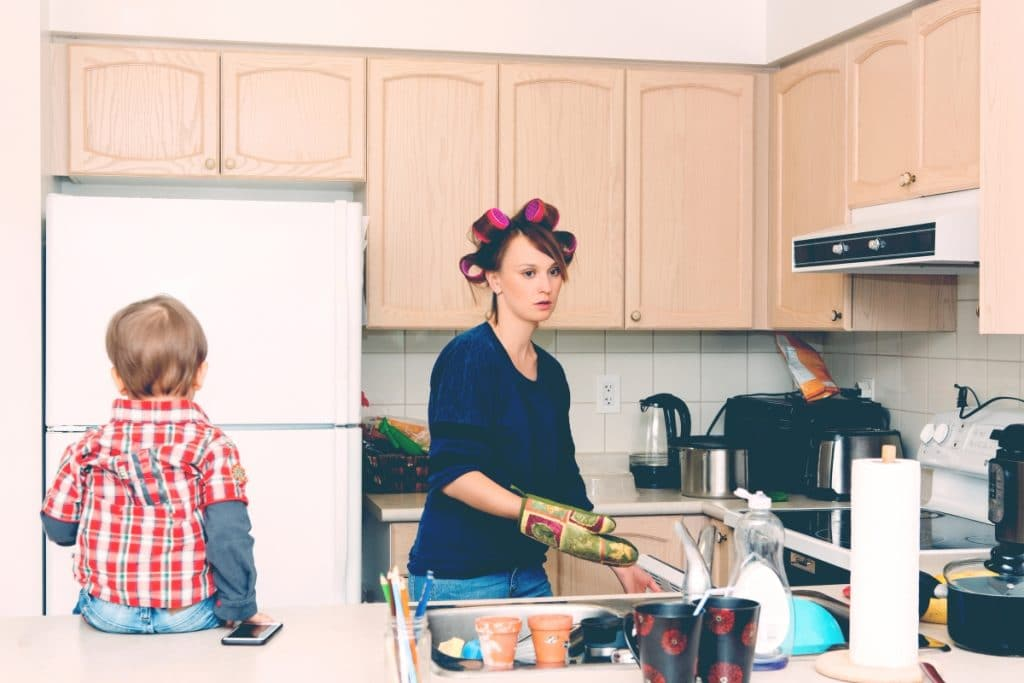overwhelmed mother in kitchen