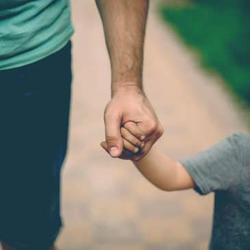 father hold kid's hand