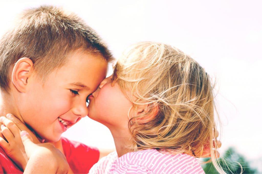 little girl kiss little boy