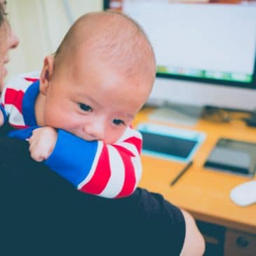 mother with baby in front of computer