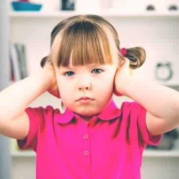 sad little kid hands on ears