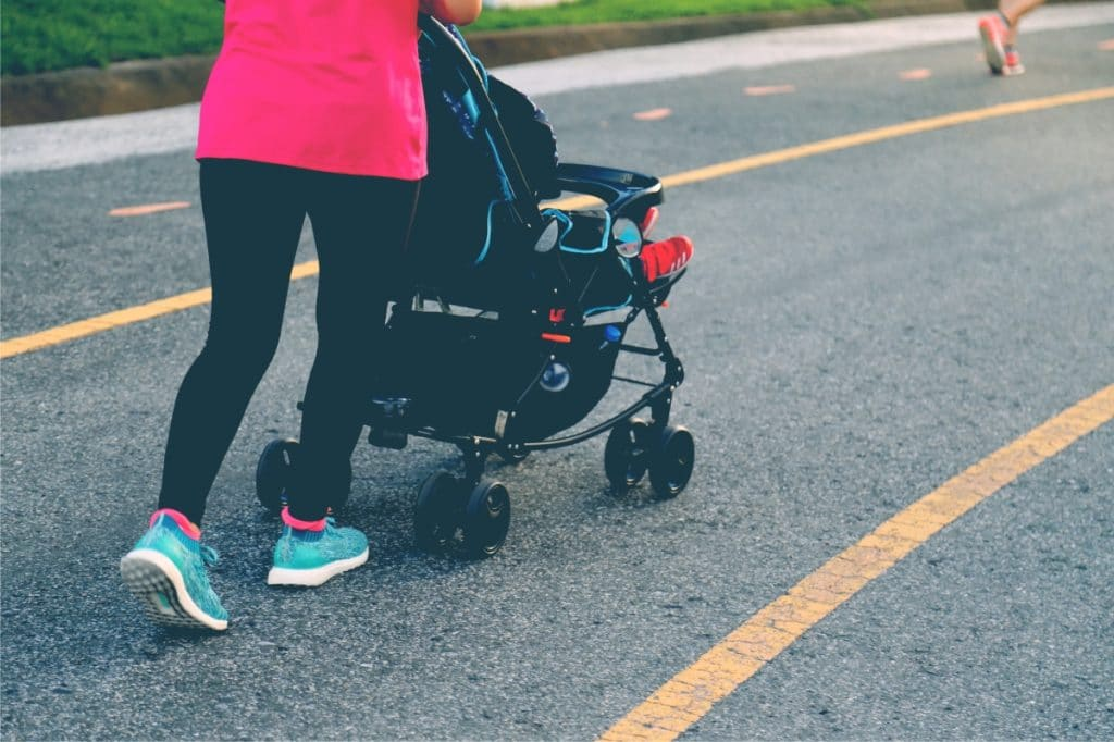 mother jogging with stroller