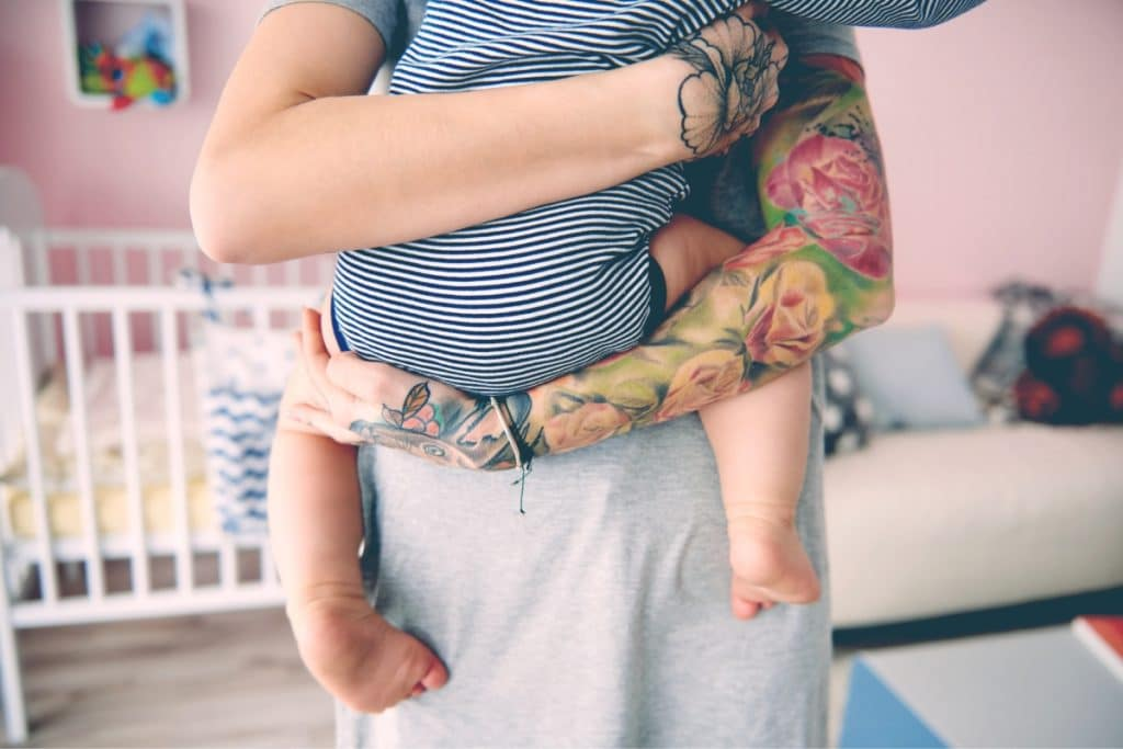 tattoo mother with baby