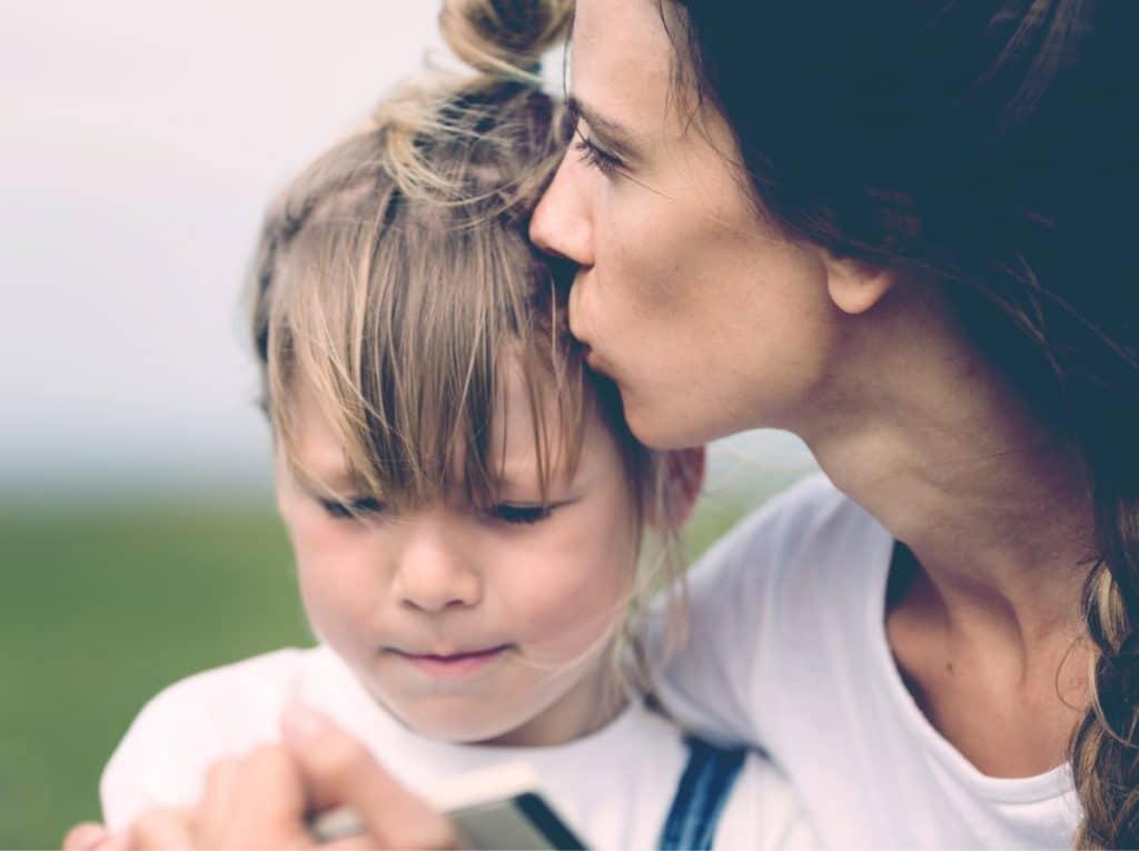 mother kiss big daughter