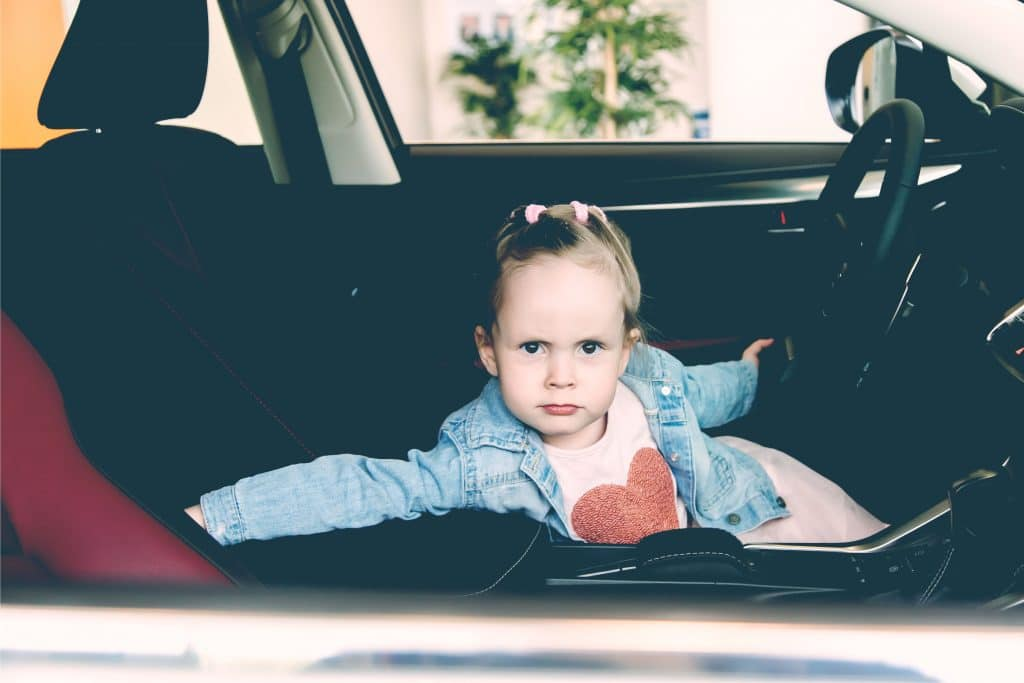 angry little kid in car