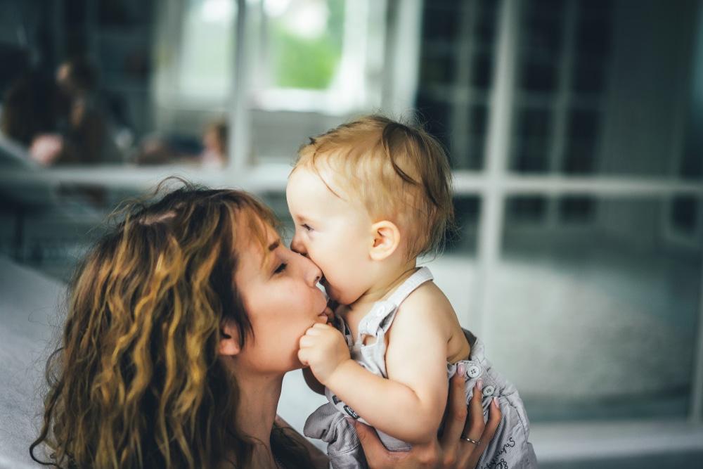 mother kiss daughter
