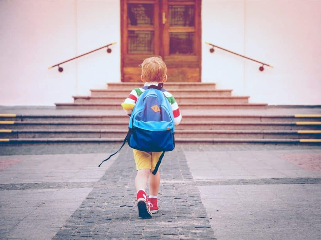 little kid going to school