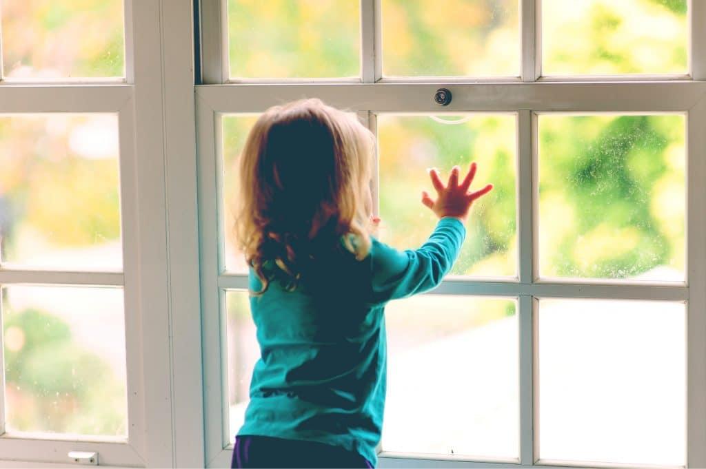 kid looking at window