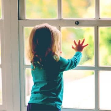 kid looking at window
