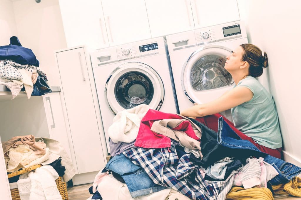 tired mother doing laundry
