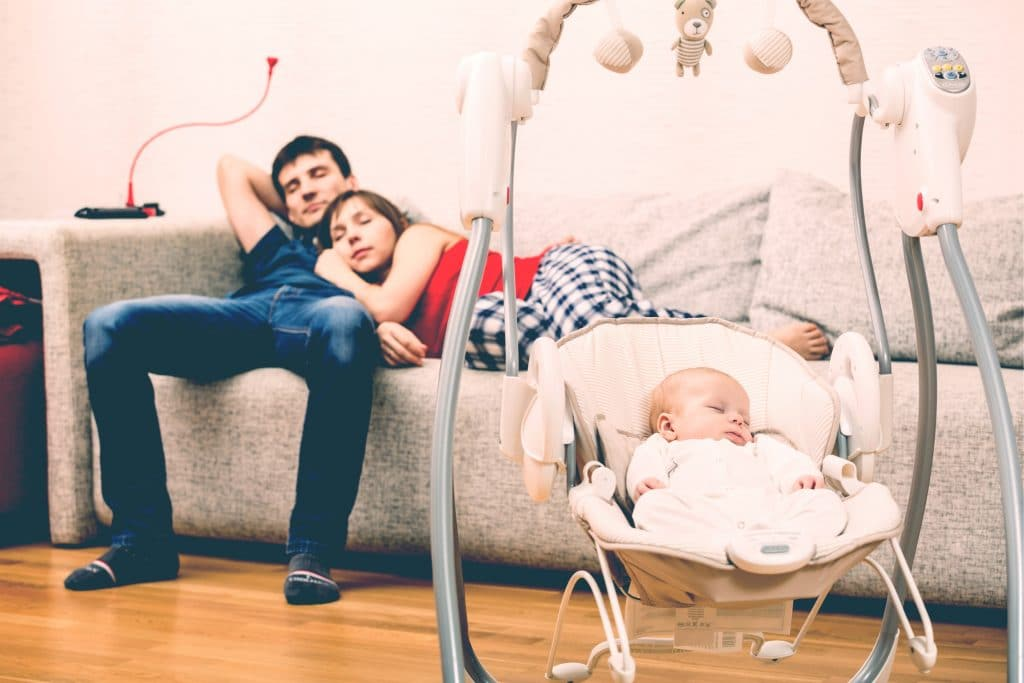 tired parents with baby