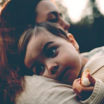 woman hug kid outisde
