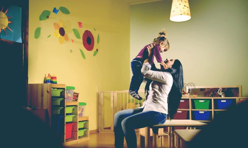 teacher and kid at kindergarten