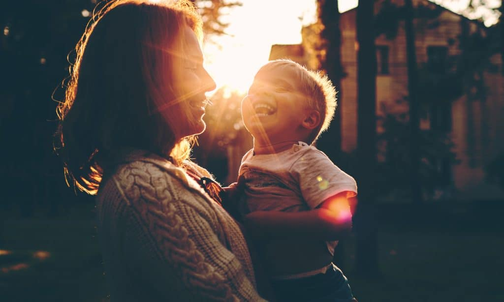 little kid with mother sun