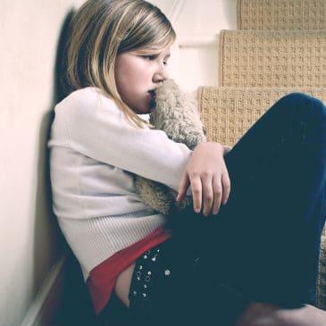 sad little girl at home