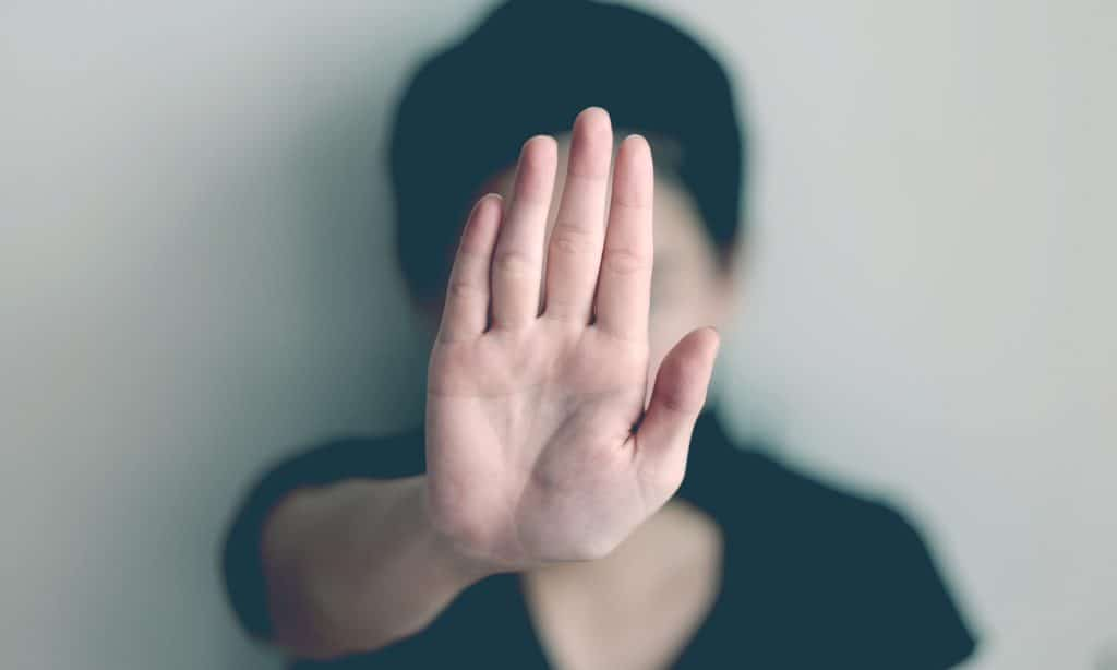 woman stop gesture