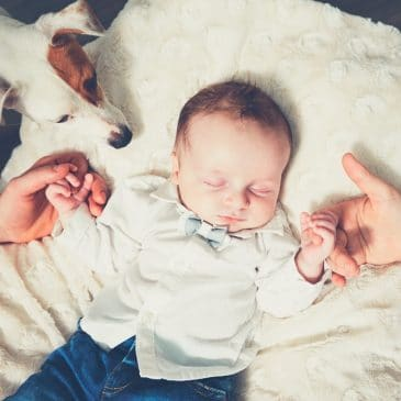 newborn with dog