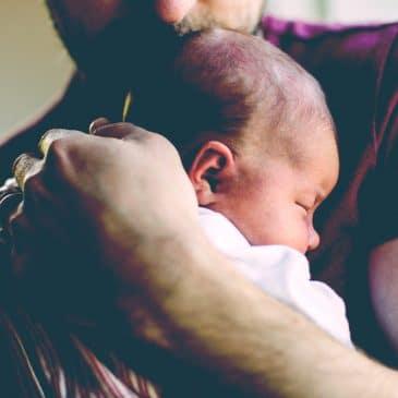 father hug baby