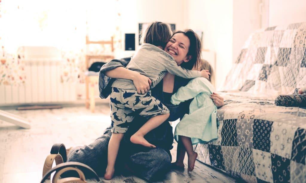 mother hug kids