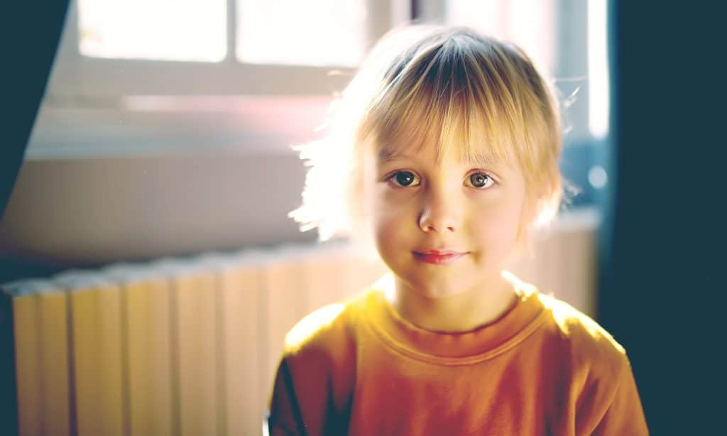 little boy in sun