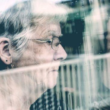 grandmother looking window