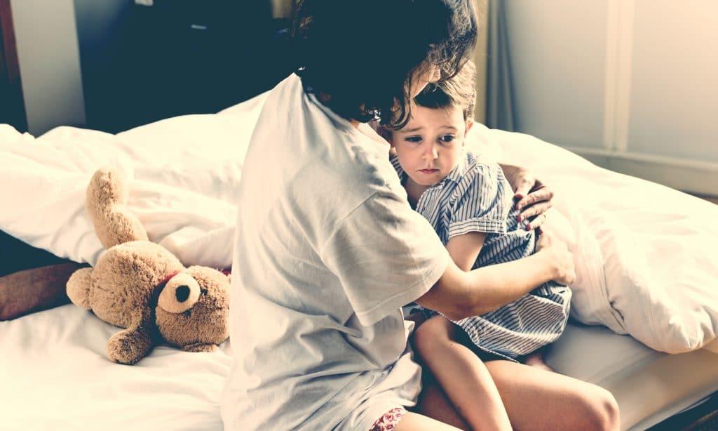 mom hold afraid kid