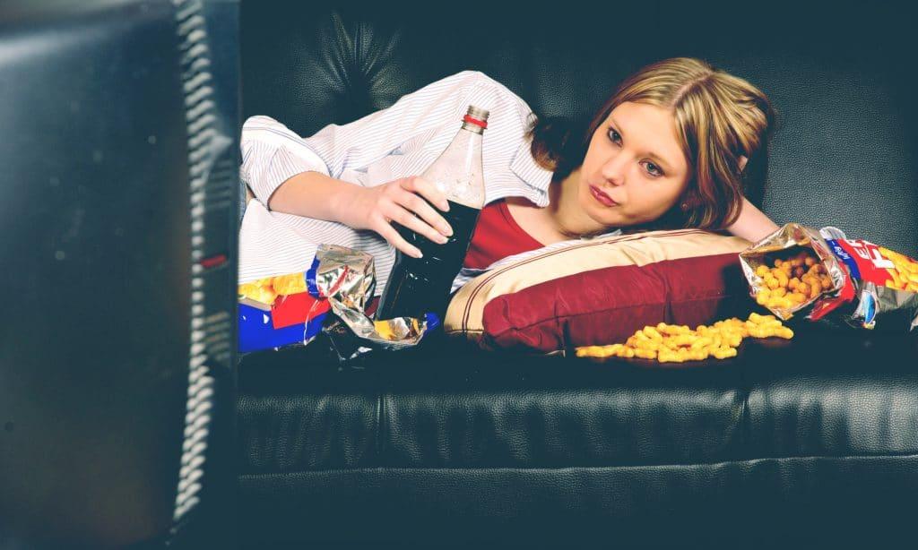 woman eat junk in living room