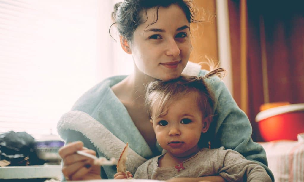 mother with kid in kitchen