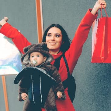 happy mother shopping with baby