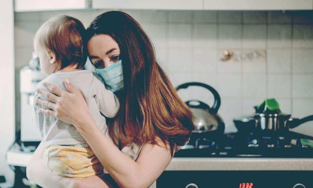 mother with mask at home