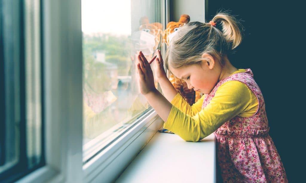 sad kid at home