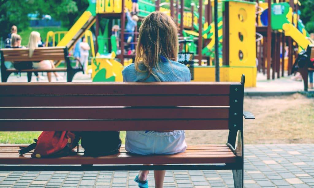 woman sit at playground