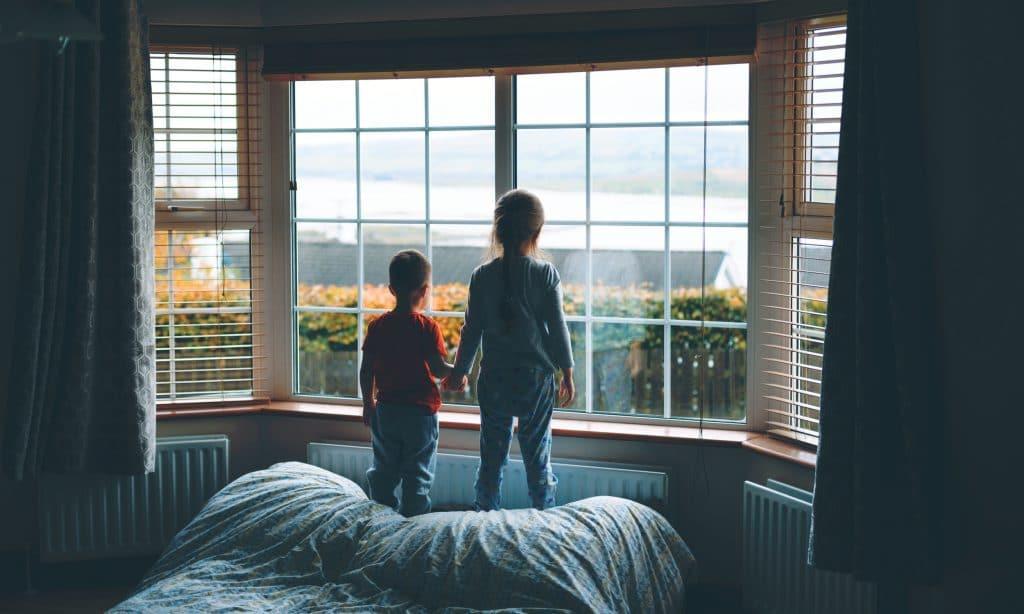 two kids in window