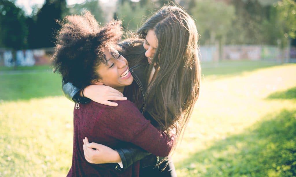 women friends caucasian african