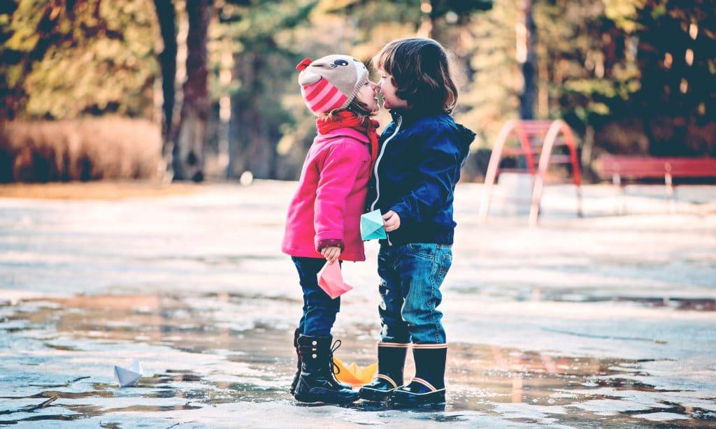 two kids kiss